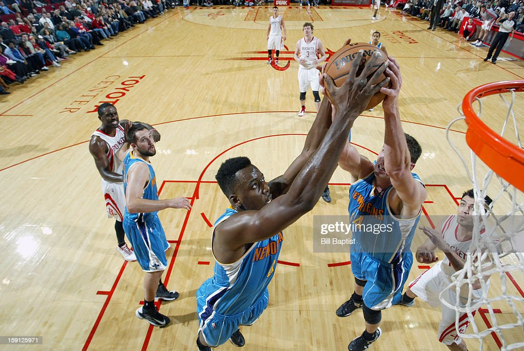 <a gi-track='captionPersonalityLinkClicked' href=/galleries/search?phrase=Al-Farouq+Aminu&family=editorial&specificpeople=5042446 ng-click='$event.stopPropagation()'>Al-Farouq Aminu</a> #0 and Jason Smith #14 of the New Orleans Hornets battle for a rebound against the Houston Rockets on January 2, 2013 at the Toyota Center in Houston, Texas.