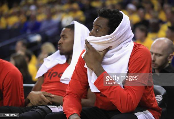 AlFarouq Aminu and Maurice Harkless of the Portland Trail Blazers sit on the bench during thei final minutes of their loss to the Golden State...