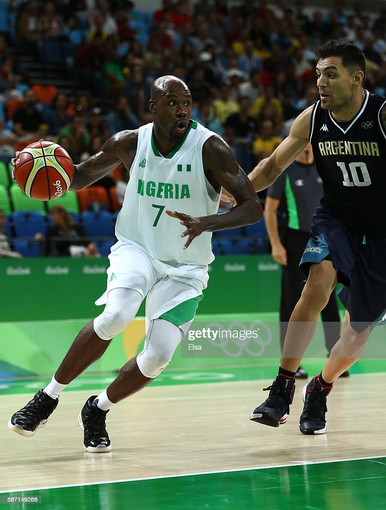 AlFarouq Aminu of Nigeria moves the ball against Carlos Delfino of Argentina during a Men's preliminary round basketball game between Nigeria and...