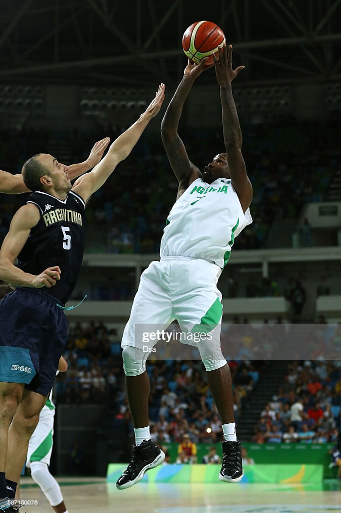 AlFarouq Aminu of Nigeria shoots over Manu Ginobili of Argentina during a Men's preliminary round basketball game between Nigeria and Argentina on...