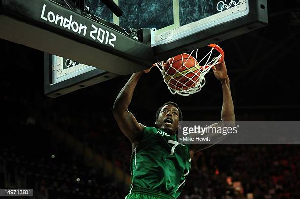 AlFarouq Aminu of Nigeria slam dunks during the Men's Basketball Preliminary Round match against the United States on Day 6 of the London 2012...