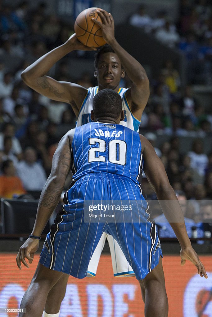 <a gi-track='captionPersonalityLinkClicked' href=/galleries/search?phrase=Al-Farouq+Aminu&family=editorial&specificpeople=5042446 ng-click='$event.stopPropagation()'>Al-Farouq Aminu</a> #0 of the New Orleans Hornets drives the ball as DeQuan Jones #20 of the Orlando Magic defends during the game between the Orlando Magic and the New Orleans Hornets on October 7, 2012 at Mexico City Arena in Mexico City.