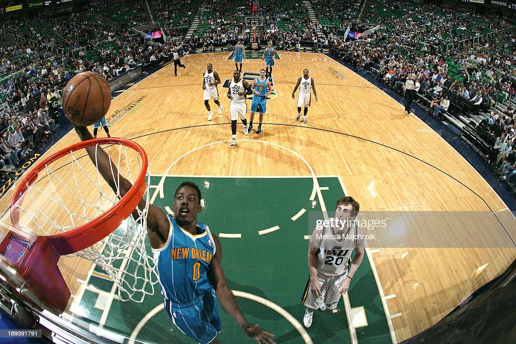 Al-Farouq Aminu #0 of the New Orleans Hornets dunks against Gordon Hayward #20 of the Utah Jazz at Energy Solutions Arena on April 5, 2013 in Salt Lake City, Utah.