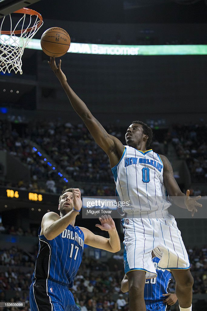 <a gi-track='captionPersonalityLinkClicked' href=/galleries/search?phrase=Al-Farouq+Aminu&family=editorial&specificpeople=5042446 ng-click='$event.stopPropagation()'>Al-Farouq Aminu</a> #0 of the New Orleans Hornets goes to the basket as <a gi-track='captionPersonalityLinkClicked' href=/galleries/search?phrase=Josh+McRoberts+-+Basketball+Player&family=editorial&specificpeople=732530 ng-click='$event.stopPropagation()'>Josh McRoberts</a> #17 of the Orlando Magic defends during the game between the Orlando Magic and the New Orleans Hornets on October 7, 2012 at Mexico City Arena in Mexico City.