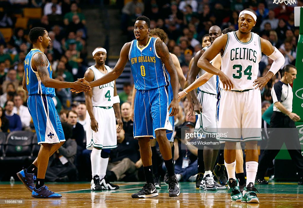 Al-Farouq Aminu #0 of the New Orleans Hornets is congratulated by teammates after being fouled against the Boston Celtics during the game on January 16, 2013 at TD Garden in Boston, Massachusetts.