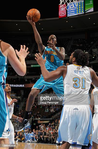 AlFarouq Aminu of the New Orleans Hornets lays up a shot against Nene Hilario of the Denver Nuggets at the Pepsi Center on January 9 2012 in Denver...