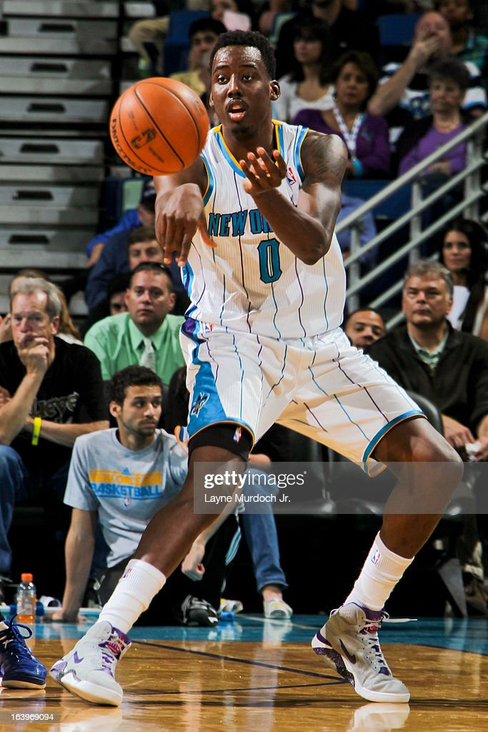 Al-Farouq Aminu #0 of the New Orleans Hornets passes the ball against the Golden State Warriors on March 18, 2013 at the New Orleans Arena in New Orleans, Louisiana.