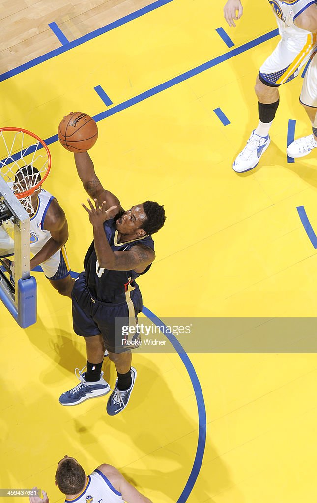 Al-Farouq Aminu #0 of the New Orleans Pelicans rebounds against the Golden State Warriors on December 17, 2013 at Oracle Arena in Oakland, California.