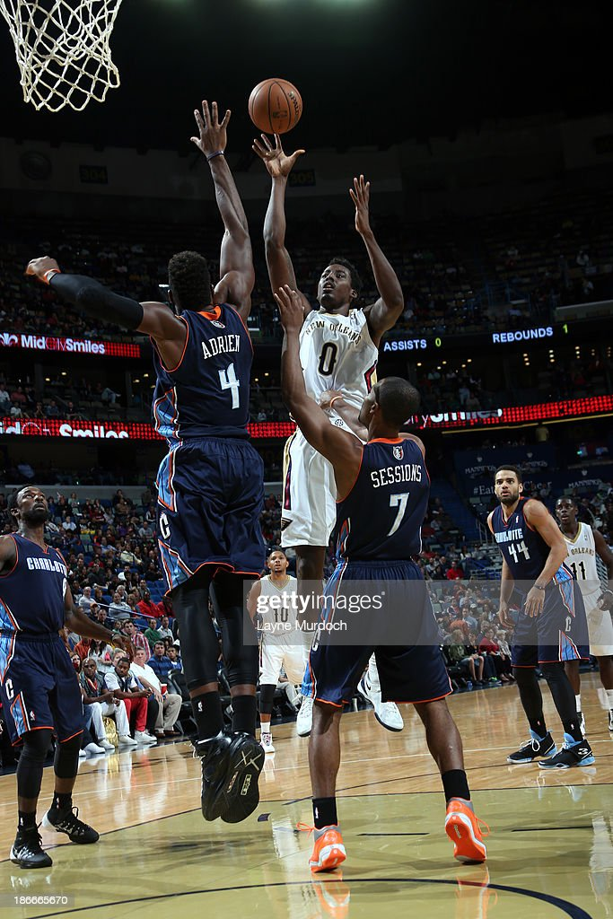<a gi-track='captionPersonalityLinkClicked' href=/galleries/search?phrase=Al-Farouq+Aminu&family=editorial&specificpeople=5042446 ng-click='$event.stopPropagation()'>Al-Farouq Aminu</a> #0 of the New Orleans Pelicans shoots against <a gi-track='captionPersonalityLinkClicked' href=/galleries/search?phrase=Jeff+Adrien&family=editorial&specificpeople=727235 ng-click='$event.stopPropagation()'>Jeff Adrien</a> #4 and <a gi-track='captionPersonalityLinkClicked' href=/galleries/search?phrase=Ramon+Sessions&family=editorial&specificpeople=805440 ng-click='$event.stopPropagation()'>Ramon Sessions</a> #7 of the Charlotte Bobcats on November 2, 2013 at the New Orleans Arena in New Orleans, Louisiana.