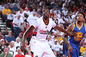 AlFarouq Aminu of the Portland Trail Blazers boxes out against Brandon Rush of the Golden State Warriors during the game in Game Three of the Western...