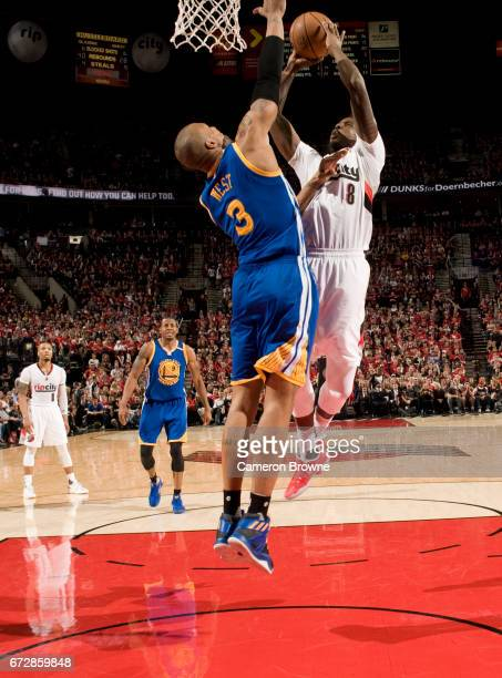 AlFarouq Aminu of the Portland Trail Blazers drives to the basket against the Golden State Warriors in Game Three of the Western Conference...
