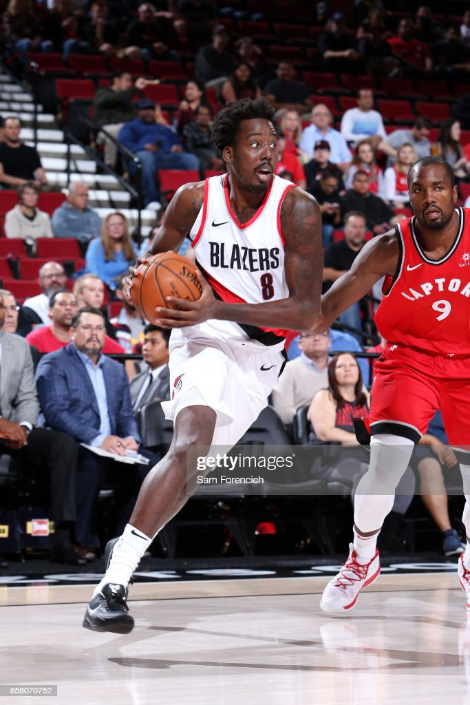 Al-Farouq Aminu #8 of the Portland Trail Blazers drives to the basket during the game against the Toronto Raptors during a preseason game on October 5, 2017 at the Moda Center in Portland, Oregon.