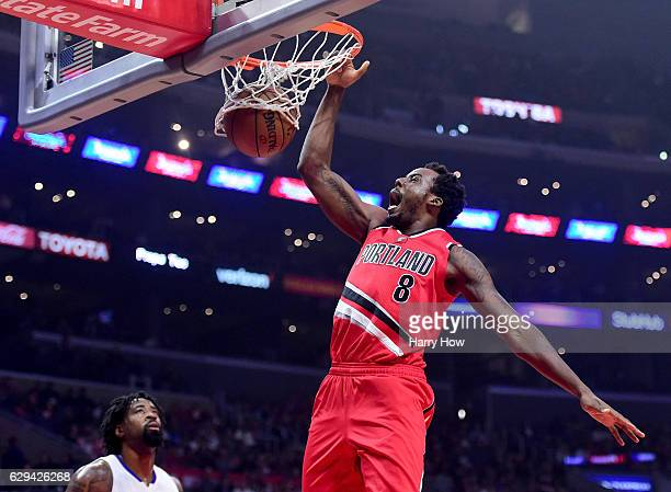 AlFarouq Aminu of the Portland Trail Blazers dunks in front of DeAndre Jordan of the LA Clippers during the first half at Staples Center on December...