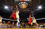 AlFarouq Aminu of the Portland Trail Blazers goes for the layup during the game against the Golden State Warriors in Game Five of the Western...