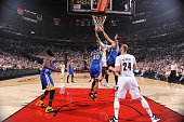 AlFarouq Aminu of the Portland Trail Blazers goes to the basket against Andrew Bogut of the Golden State Warriors in Game Four of the Western...