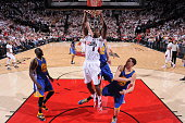 AlFarouq Aminu of the Portland Trail Blazers goes to the basket against the Golden State Warriors in Game Four of the Western Conference Semifinals...
