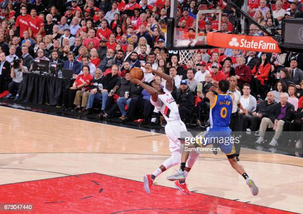 AlFarouq Aminu of the Portland Trail Blazers goes to the basket against the Golden State Warriors during Game Four of the Western Conference...