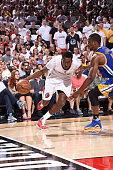 AlFarouq Aminu of the Portland Trail Blazers handles the ball against the Golden State Warriors in Game Three of the Western Conference Semifinals...