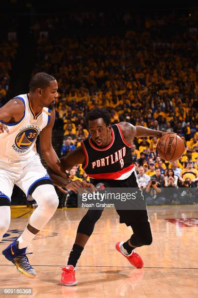 AlFarouq Aminu of the Portland Trail Blazers handles the ball against the Golden State Warriors during the Western Conference Quarterfinals of the...