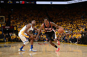 AlFarouq Aminu of the Portland Trail Blazers handles the ball during the game against Harrison Barnes of the Golden State Warriors in Game Two of the...