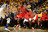 AlFarouq Aminu of the Portland Trail Blazers handles the ball during the game against Draymond Green of the Golden State Warriors in Game Five of the...