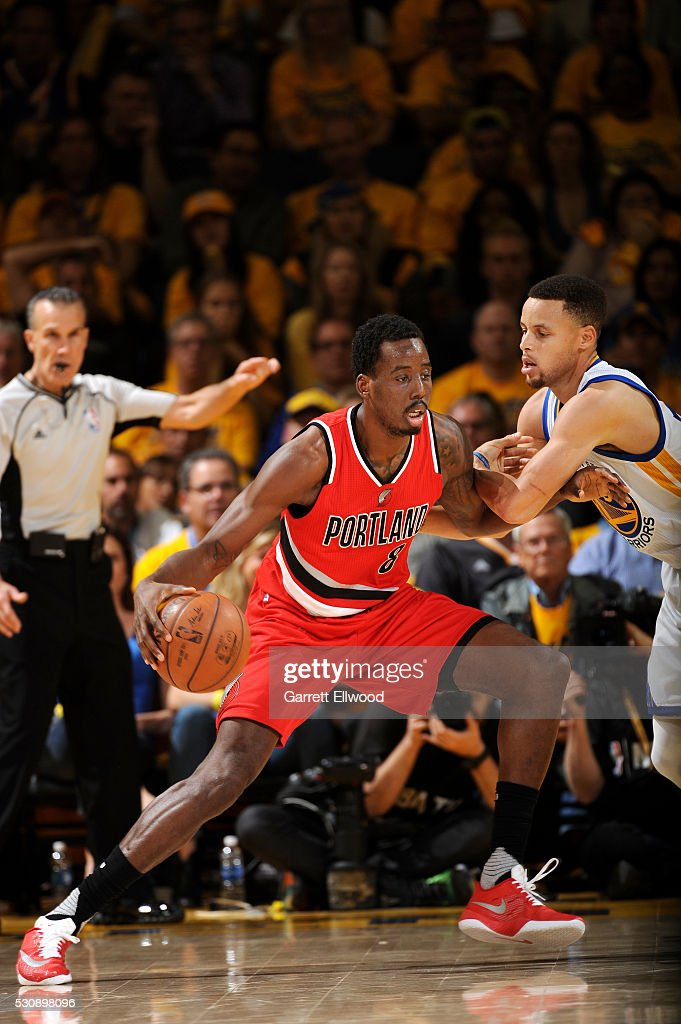 AlFarouq Aminu of the Portland Trail Blazers handles the ball during the game against Stephen Curry of the Golden State Warriors in Game Five of the...