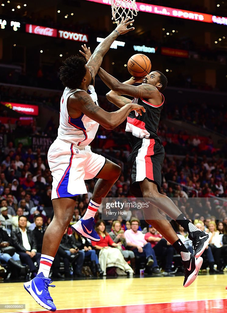 AlFarouq Aminu of the Portland Trail Blazers has his shot contested by DeAndre Jordan of the Los Angeles Clippers during the first half at Staples...