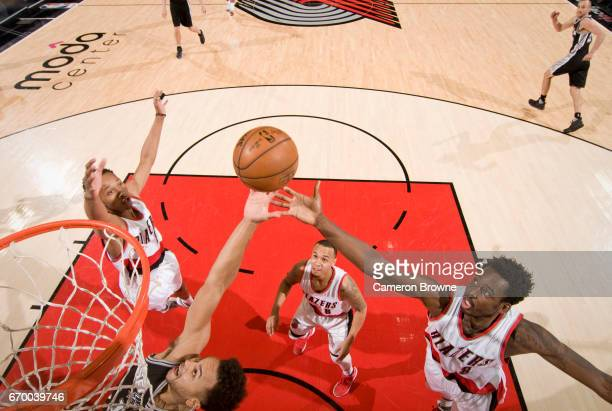 AlFarouq Aminu of the Portland Trail Blazers jumps for the rebound against the San Antonio Spurs on April 10 2017 at the Moda Center in Portland...