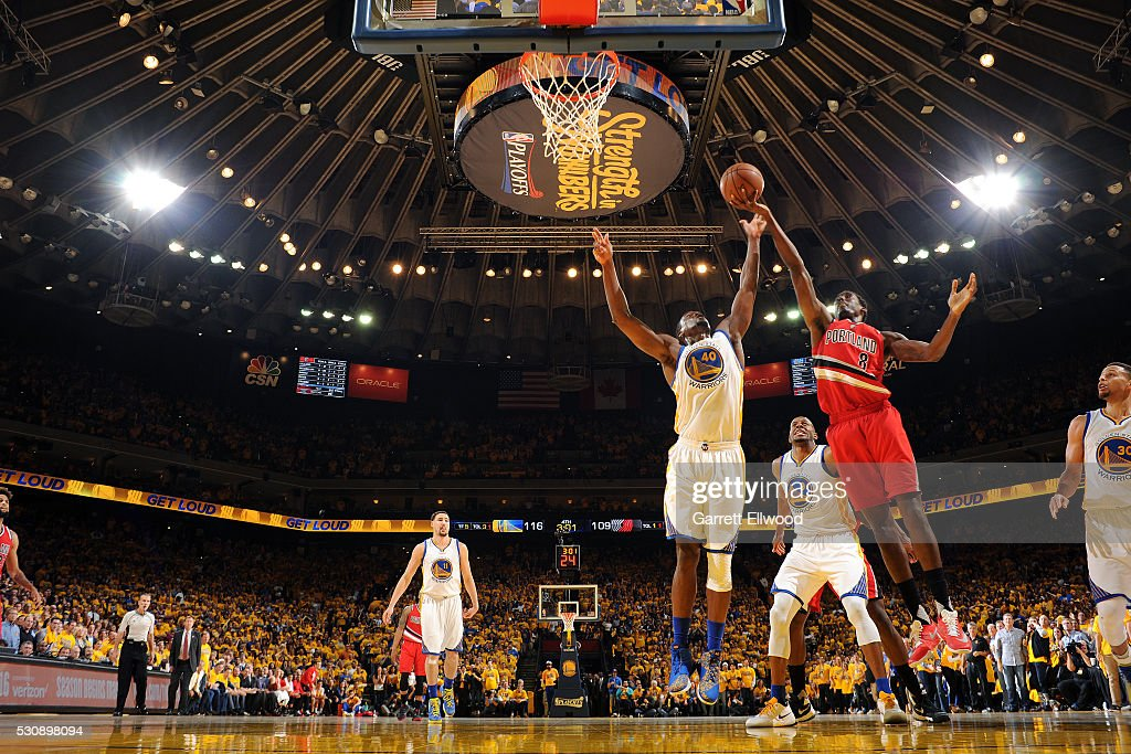 AlFarouq Aminu of the Portland Trail Blazers shoots a layup during the game against Harrison Barnes of the Golden State Warriors in Game Five of the...