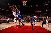 AlFarouq Aminu of the Portland Trail Blazers shoots against Festus Ezeli of the Golden State Warriors in Game Three of the Western Conference...