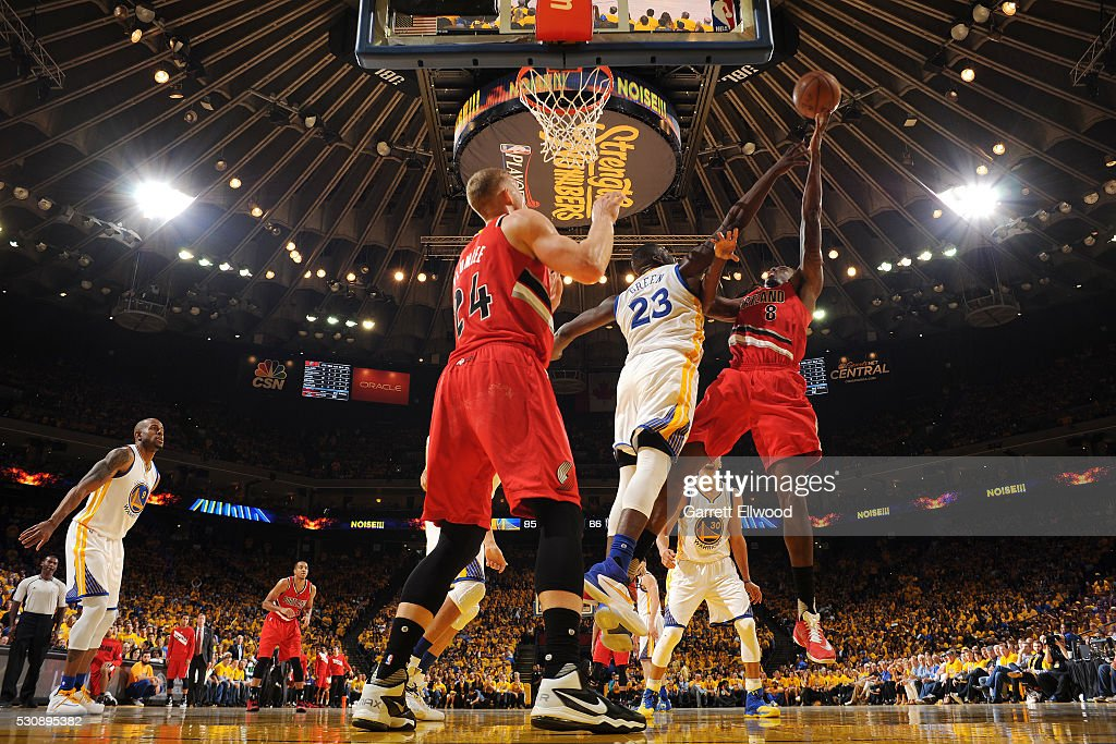 AlFarouq Aminu of the Portland Trail Blazers shoots the ball during the game against Draymond Green of the Golden State Warriors in Game Five of the...