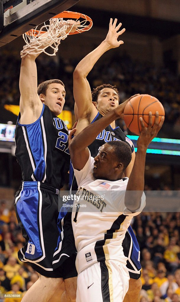 AlFarouq Aminu of the Wake Forest Demon Deacons drives to the basket on Miles Plumlee and Brian Zoubek of the Duke Blue Devils during the first half...