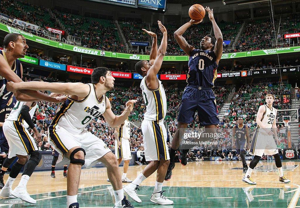 Al-Farouq #0 of the New Orleans Pelicans shoots against Alec Burks #10 of the Utah Jazz at EnergySolutions Arena on April 04, 2014 in Salt Lake City, Utah.