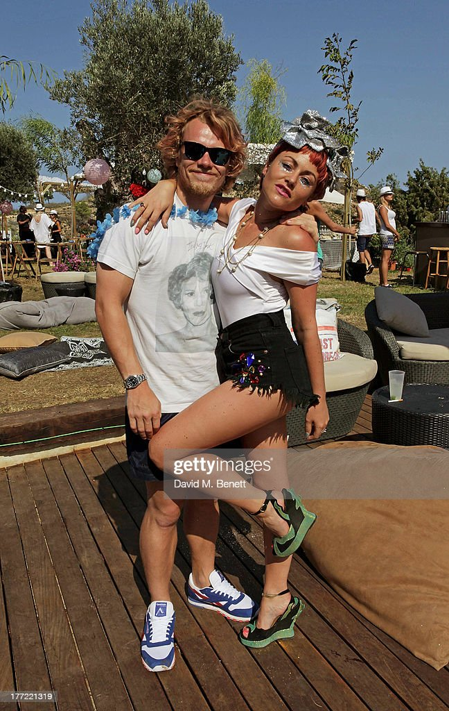 Alfie Allen (L) and Jaime Winstone attend the Ibiza Summer Party at Can Batista on August 22, 2013 in Ibiza, Spain.