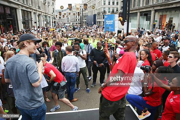Alfie Allen and Mo Farah take part in the Unlimited London Parade on July 24 2016 in London England
