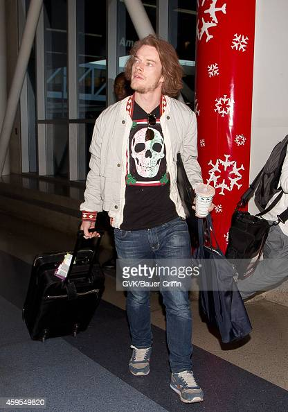 Alfie Allen seen at LAX on November 24 2014 in Los Angeles California