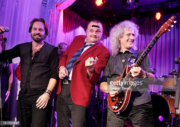 Alfie Boe Al Murray and Brian May perform during the second annual 'Freddie For A Day' event in memory of Queen's late frontman Freddie Mercury at...