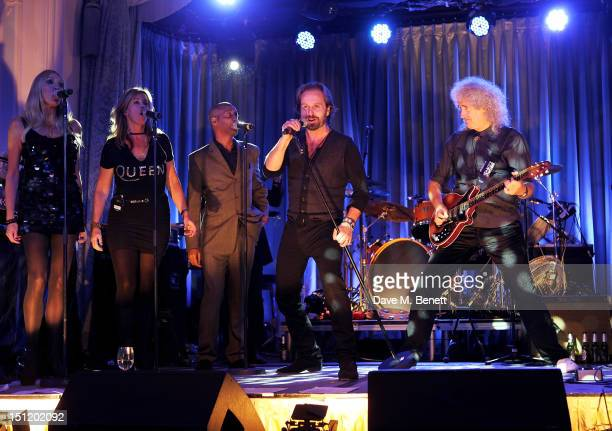 Alfie Boe and Brian May perform during the second annual 'Freddie For A Day' event in memory of Queen's late frontman Freddie Mercury at The Savoy...