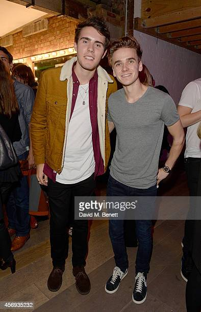 Alfie Deyes and Joe Sugg attend as Ruth Crilly unveils a new haircare sensation 'Colab' on October 9 2014 in London England