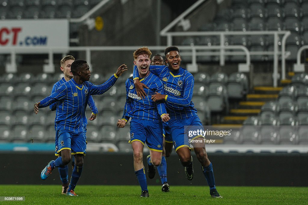 Alfie Egan (C) of Wimbledon celebrates after scoring his second and winning goal during the U18 FA Youth Cup Match between Newcastle United and AFC Wimbledon at St.James' Park on January 6, 2015, in Ilkeston, England.