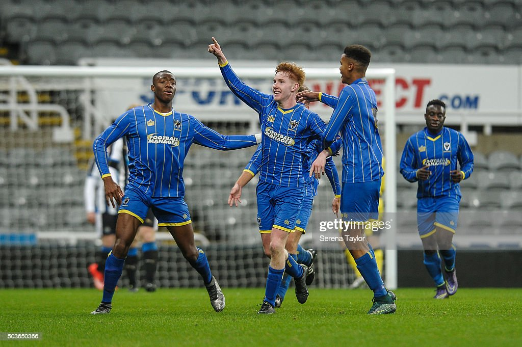 Alfie Egan (C) of Wimbledon celebrates after scoring the opening goal during the U18 FA Youth Cup Match between Newcastle United and AFC Wimbledon at St.James' Park on January 6, 2015, in Ilkeston, England.
