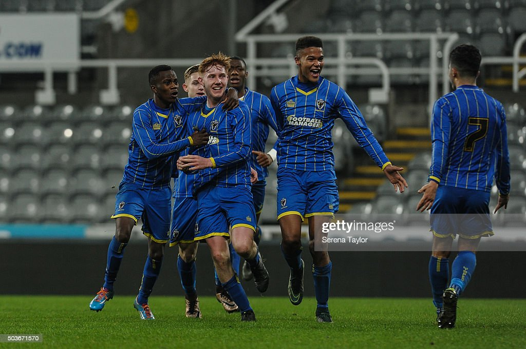 Alfie Egan (second from left) of Wimbledon celebrates with teammates after scoring his second and winning goal during the U18 FA Youth Cup Match between Newcastle United and AFC Wimbledon at St.James' Park on January 6, 2015, in Ilkeston, England.