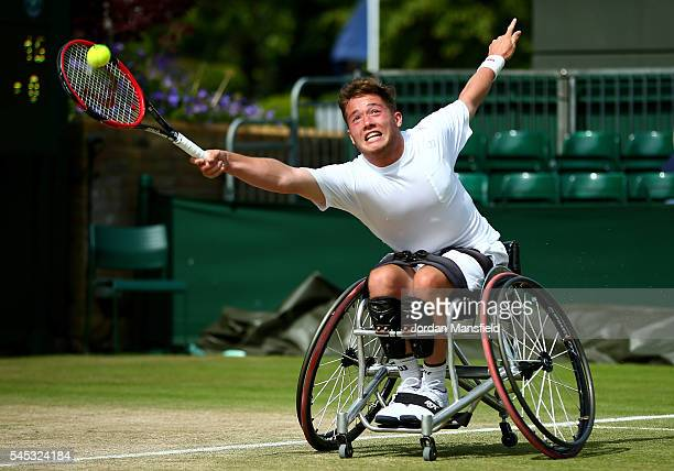 Alfie Hewett of Great Britain plays a forehand during the Men's Wheelchair Singles against Joachim Gerard of Belgium on day ten of the Wimbledon Lawn...