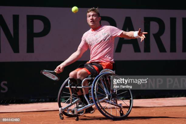 Alfie Hewett of Great Britain plays a forehand during the mens singles wheelchair final match against Gustavo Fernandez of Argentina on day fourteen...