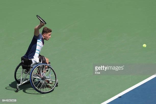 Alfie Hewett of Great Britain returns a shot against Gordon Reid of Great Britain in their Wheelchair Men's Singles semifinal match on Day Thirteen...