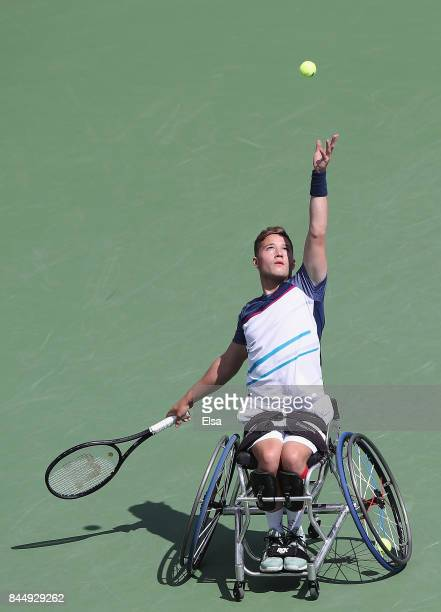 Alfie Hewett of Great Britain serves against Gordon Reid of Great Britain in their Wheelchair Men's Singles semifinal match on Day Thirteen of the...