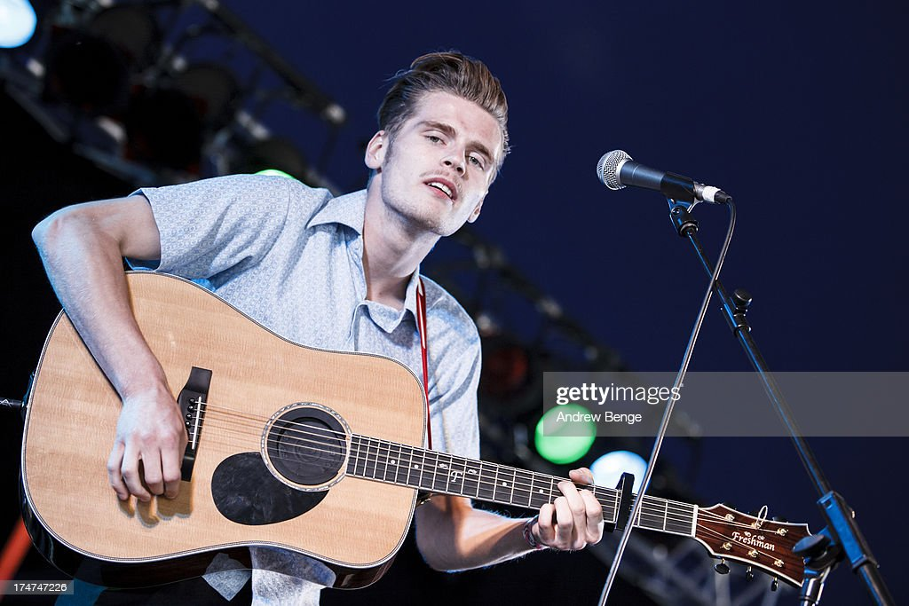 Alfie Hudson-Taylor of Hudson Taylor performs on stage on Day 3 of Kendal Calling Festival at Lowther Deer Park on July 28, 2013 in Kendal, England.