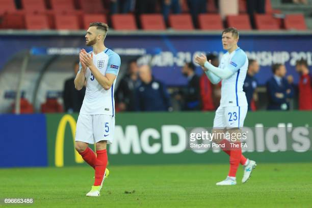 Alfie Mawson and Calum Chambers of England applaud the travelling fans after the UEFA European Under21 Championship match between Sweden and England...