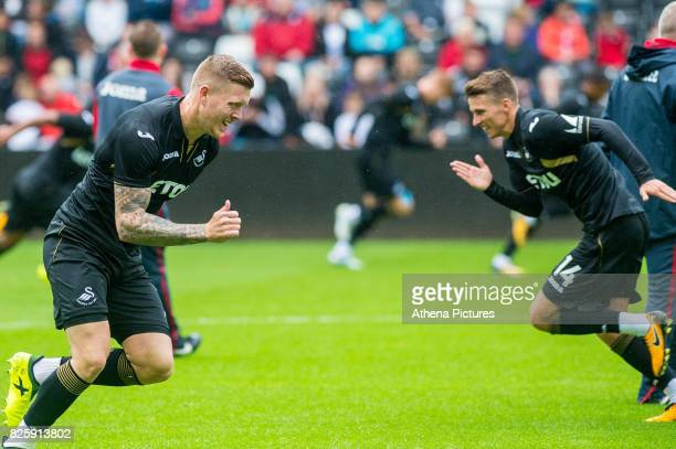 Alfie Mawson and Tom Caroll warm up during the Swansea City Training SessionThe Liberty Stadium on August 02 2017 in Swansea Wales