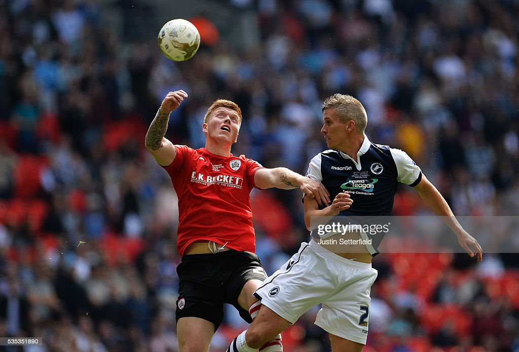 Alfie Mawson of Barnsley FC and Steve Morison of Millwall FC during the Sky Bet League One Play Off Final between Barnsley and Millwall at Wembley Stadium on May 29, 2016 in London, England.